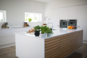 white kitchen island with wood panels