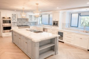 white marble kitchen island with grey base cabinets