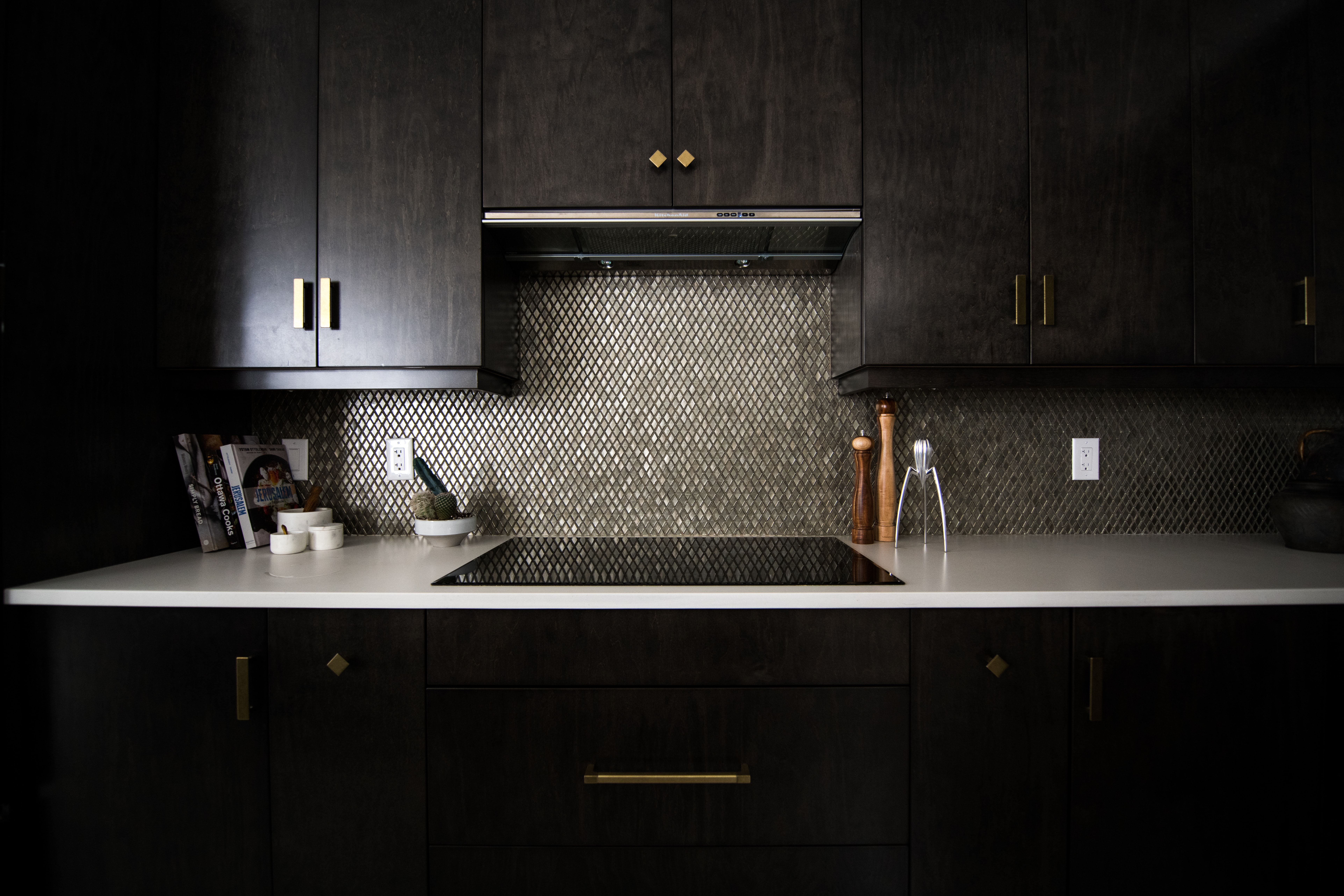 penny tile backsplash with dark cabinetry