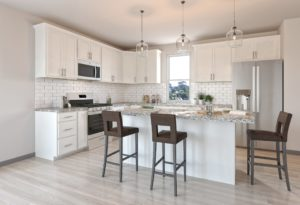 kitchen with white cabinets and light brown flooring