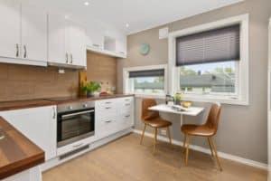 white kitchen cabinets against brown walls