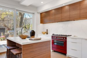 kitchen with white walls and walnut cabinets
