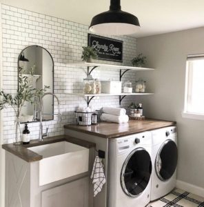 laundry room with penny tile walls