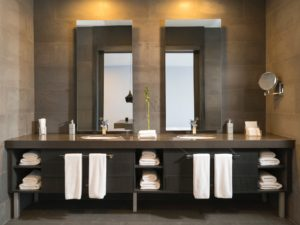 double mirrors over dark colored vanity