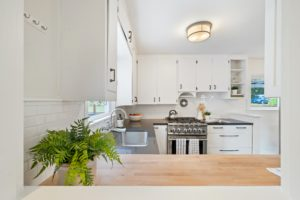 kitchen with white walls and cabinets