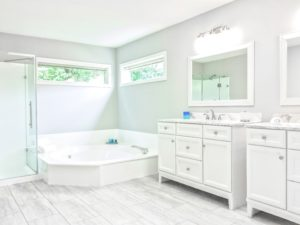 mirrored medicine cabinet above white bathroom vanity